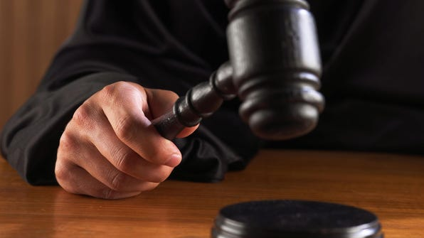 A file photo of a judge hitting gavel.