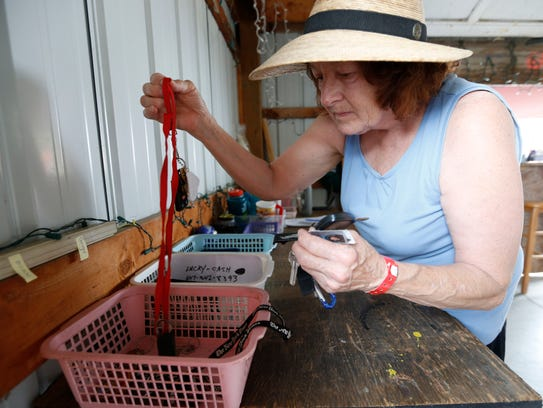 Peggy Long sorts through sets of keys at the lost and