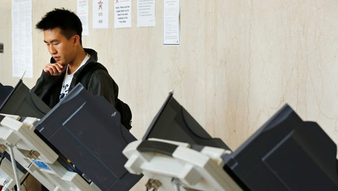 Taewon Kang casts his ballot Thursday, October 15, 2015, at the early voting center inside Stewart Center on the campus of Purdue University. The vote center inside Stewart was open from 9 a.m til 4 p.m. Kang voted just before the vote center closed at 3:53 p.m.