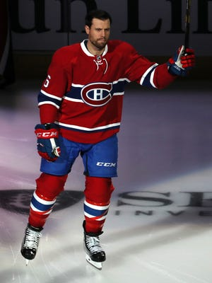 Defenseman Shea Weber waves to the crowd before his first regular-season game as a member of the Montreal Canadiens.