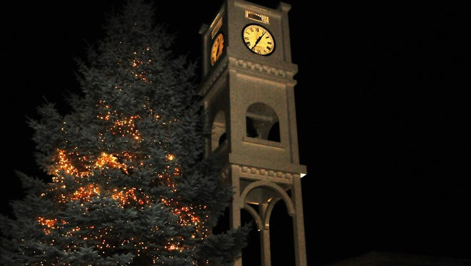 "The Christmas tree lighting under the Baylake Bank clock tower on North Third Avenue in Sturgeon Bay helps kick off the city's annual ""Christmas By the Bay"" celebration."