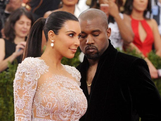 Kim Kardashian and Kanye West arrive at The Metropolitan Museum of Art's Costume Institute benefit gala May 4 in New York.