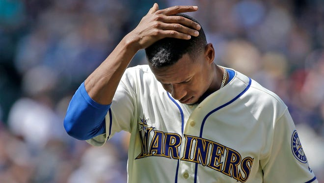 Seattle Mariners starting pitcher Ariel Miranda leaves a baseball game after being relieved in the eighth inning of a baseball game against the Houston Astros, Sunday, June 25, 2017, in Seattle. (AP Photo/Elaine Thompson)