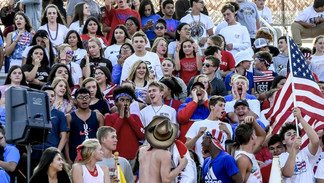 Garden City High School students fill a portion of the home grandstands as they cheer for the Buffalo football team during a September 2019 game at Buffalo Stadium. Public attendance at games this year will have a different look in the COVID-19 pandemic.