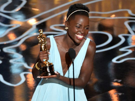 Lupita Nyong'o accepts the Oscar for best supporting actress.