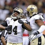 New Orleans Saints defensive end Cameron Jordan (94) and nose tackle Austin Brown (71) celebrate a defensive play against the Atlanta Falcons in the second half of their game at the Mercedes-Benz Superdome.