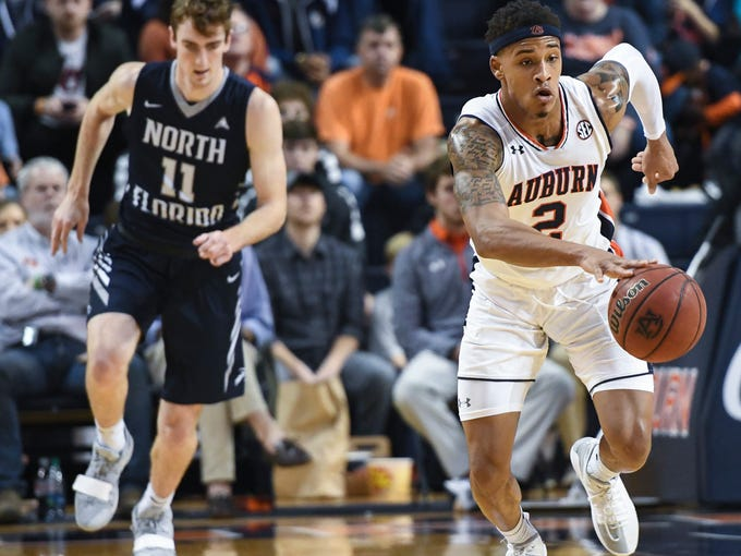 Auburn guard Bryce Brown (2) grabs the ball away from North Florida during the first half of an NCAA college basketball game Saturday, Dec. 29, 2018, in Auburn, Ala. (AP Photo/Julie Bennett)