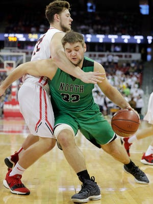 Oshkosh North's Matt Hickey works inside against Sussex Hamilton's Ryan Filo during Friday's WIAA Division 1 boys basketball state semifinal at the Kohl Center in Madison.