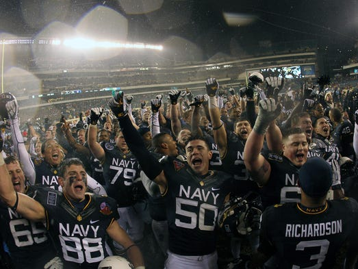 The Navy celebrates its 34-7 win, the 12th victory in a row against Army for the Midshipmen.