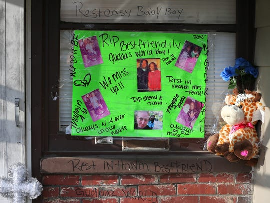 A poster with pictures of the victims of a quadruple homicide is posted on the house where the crime took place before a vigil at 3145 North Harding Street on Thursday, March 26, 2015. On Wednesday, the Marion County coroner's office identified the quadruple homicide victims as 18-year-old Davon Whitlock, 32-year-old Tiara Turner, 41-year-old Terri Betties and 48-year-old Sherry Taylor, all of Indianapolis.