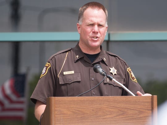 Calhoun County Sheriff Matt Saxton speaks to the crowd during a pro-law enforcement rally in 2015.