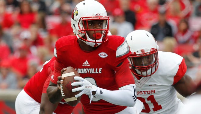 University of Louisville quarterback LaMar Jackson (8) is pressured by the University of Houston's Tyus Powers (81) during the first half at Papa John's Stadium in Louisville, Kentucky. September 12, 2015