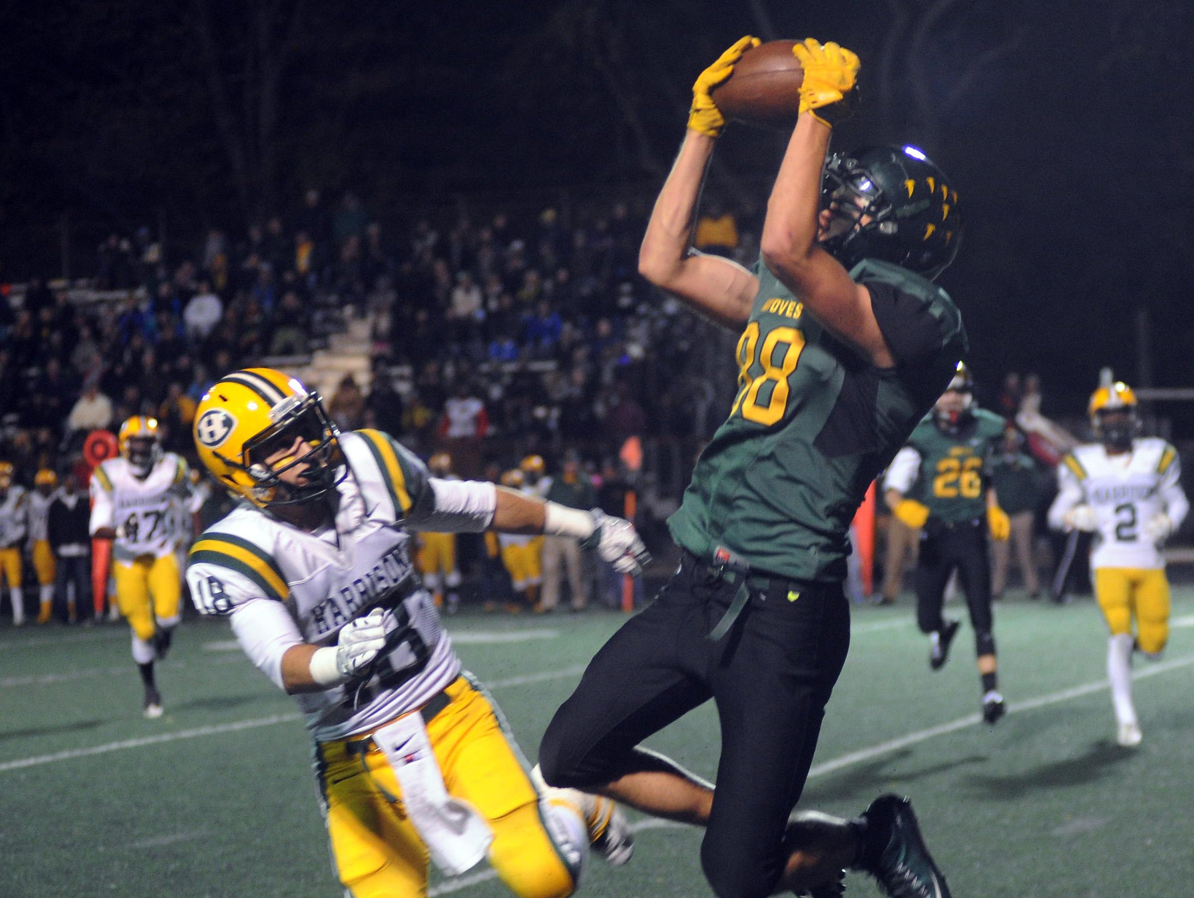 Groves tight end Drew Sheckell (88) corrals a clutch third-quarter pass much to the dismay of Harrison defender Theo Lucas (18).