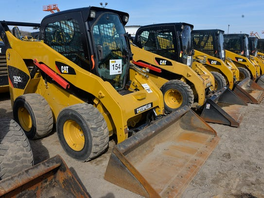 About 50 skid steers and compact tracked loaders are