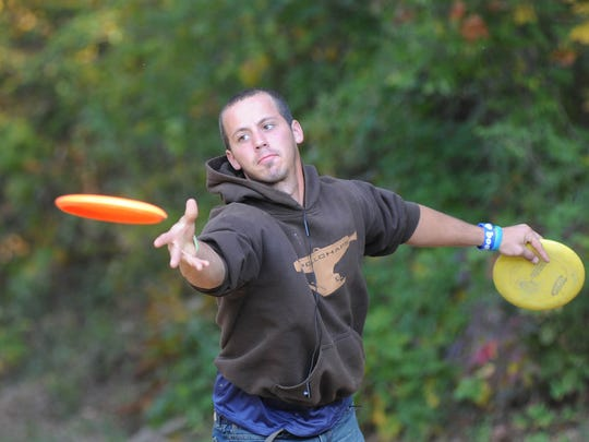 In this Nov. 4, 2011 file photo, Brad Sherbert practices at the disc golf course at Chautauqua Lake in Crystal Springs in preparation for the Chautauqua Park Open.
