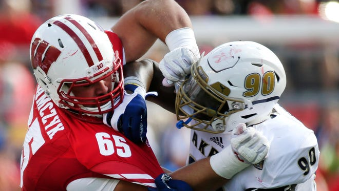 Wisconsin left tackle Ryan Ramczyk (left) projects as a potential first-round pick in next year's draft.