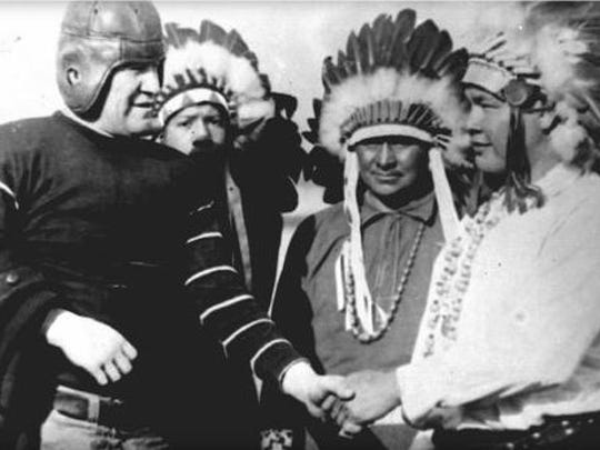 Jim Thorpe, left, is greeted by a group of American Indians from a nearby reservation at St. Petersburg, Fla