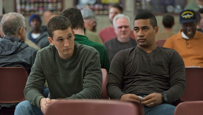 "This image released by DreamWorks Pictures shows Miles Teller, left, and Beulah Koale in a scene from,""Thank You for Your Service."" The drama follows a group of U.S. soldiers returning from Iraq who struggle to integrate back into family and civilian life. (Francois Duhamel/DreamWorks Pictures via AP) ORG XMIT: NYET803"
