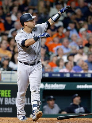 New York Yankees' catcher Gary Sanchez (24) watches his home run hit for three runs in the ninth inning of a baseball game against the Houston Astros Tuesday, May 1, 2018, in Houston.