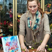 Colleen Niemuth, of Caan Floral and Greenhouses, is one of seven area floral designers who created floral arrangements that will be paired with artwork created by local artists during a show Friday at EBCO Artworks in Sheboygan.