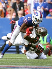 Bills receiver Zay Jones looks for yards after a catch