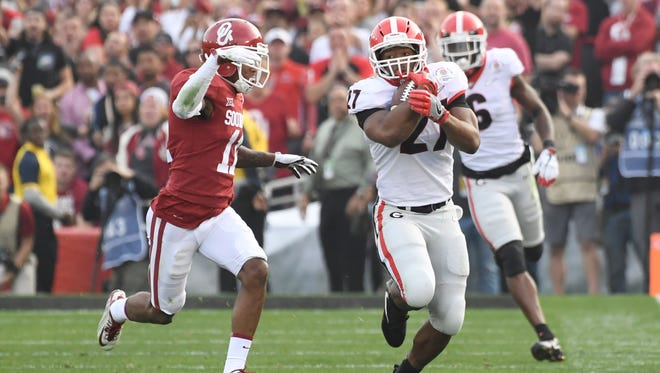 Georgia Bulldogs running back Nick Chubb churns out yards vs. Oklahoma in the Rose Bowl.