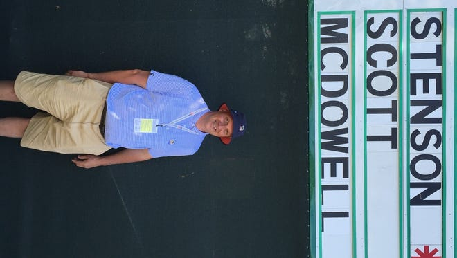 Larry Strawoet stands in front of the scoreboard near the No. 18 green at Oakmont during the U.S. Open Championship's second round Friday. He is working as a USGA volunteer this week.