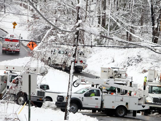 9:14 a.m. Utility crews work to restore power on Drewville