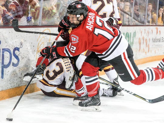 St. Cloud State defenseman Jack Ahcan controls the