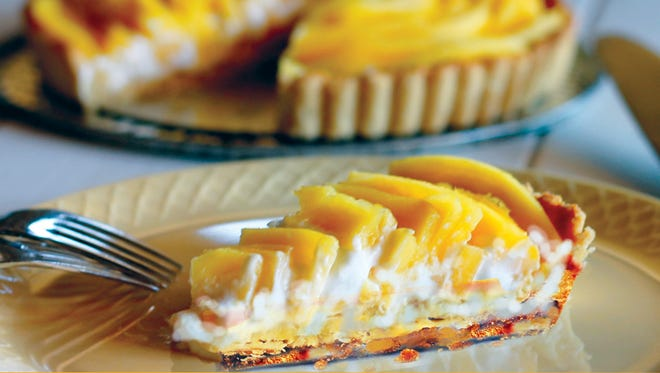 Spread mango-ice cream mix onto chilled, cookie crumb crust. Chill in freezer until set, garnish with mango slices before serving.