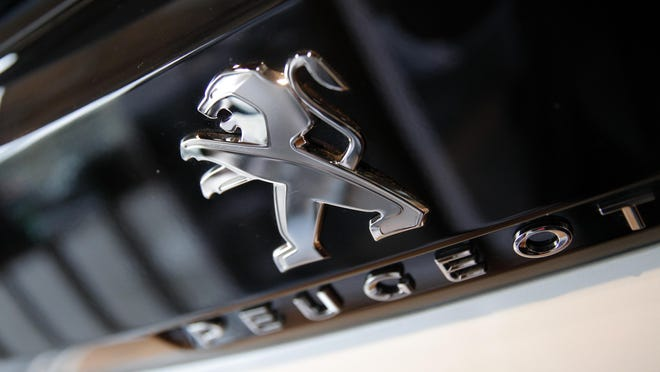 The logo of French automaker Peugeot is pictured.