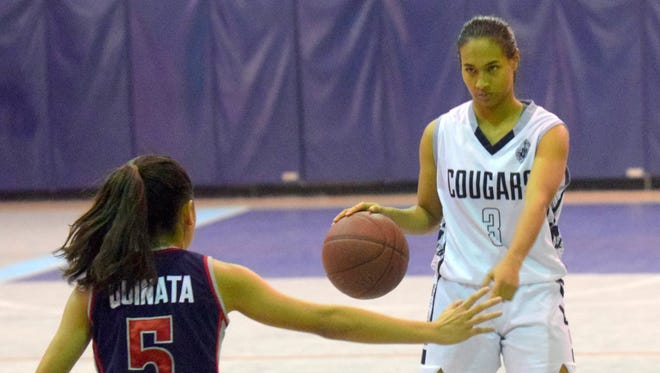 Academy of Our Lady of Guam Cougars' Kali Benavente is plays against the Okkodo Bulldogs during the 2015 IIAAG girls' basketball season where she was named MVP. Benavente earned another MVP award leading the Cougars to the Hardeman Showcase Basketball championship on Jan. 23