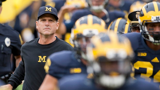 Jim Harbaugh led the Wolverines to a 9-3 record and a New Year's Day bowl game in his first season.