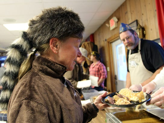Coon Feed diner Tiger Krawczyk dons a fitting hat while