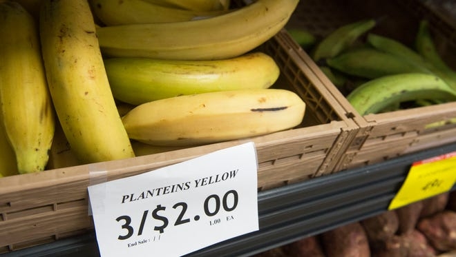 Yellow plantains sit on a shelf at the new Shop Smart Supermarket in York.