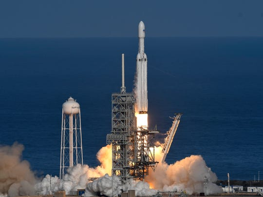 SpaceX's Falcon Heavy rocket lifts off from Kennedy