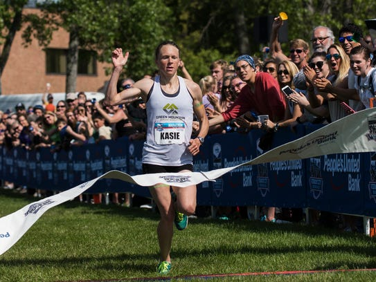 Vermont's Kasie Enman crosses the finish line in first