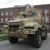 An armored military vehicle that is property of the Christian County Sheriff's Office sits on the driveway of the Christian County Historic Courthouse in Ozark. The U.S. Army removed mounted guns from it before turning it over.