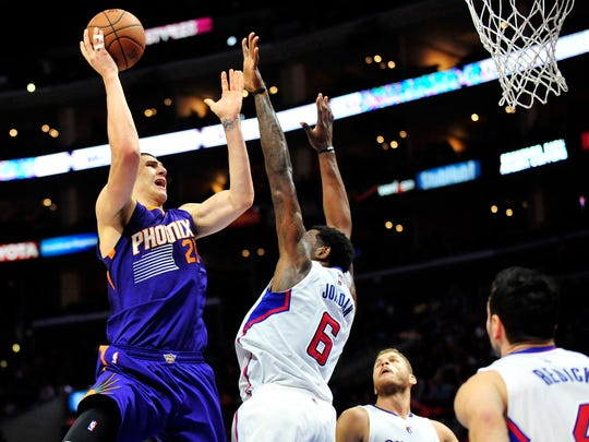 Suns center Alex Len (21) shoots over the defense of the Clippers on Nov. 15, 2014 at Staples Center in Los Angeles.