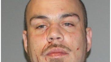 Lansing man charged in home invasion
