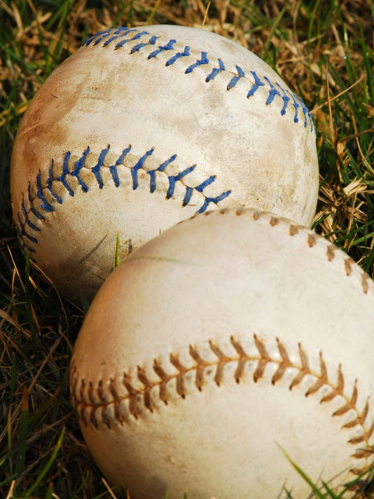 636277305379358758-softballs-in-grass---vertical.jpg