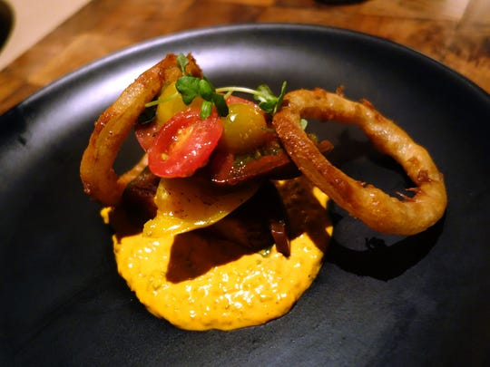 Heirloom tomatoes with crispy onions and Russian dressing