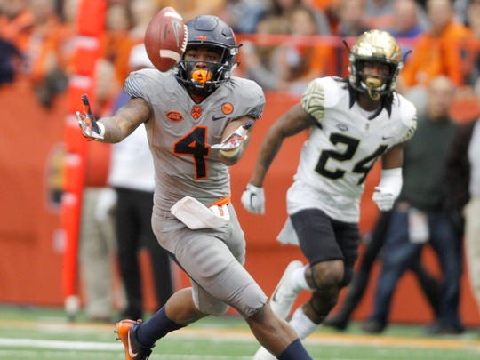 Syracuse's Dontae Strickland, left, makes a catch against Wake Forest in 2017.