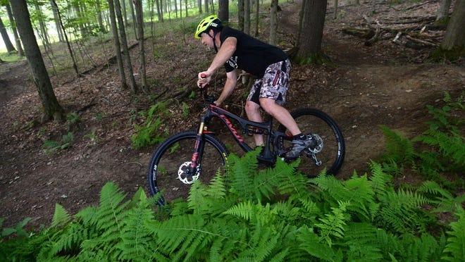 Don Farbotnik, trail gnome for the mountain bike trails at  Mount Pleasant of Edinboro, rides the trails July 25. Farbotnik also maintains the trails with a crew of volunteers.