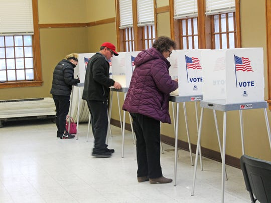 Voters cast their ballots at West Branch Town Hall on a $19 million bond issue to provide dollars for school facility upgrades on Feb. 7, 2017.
