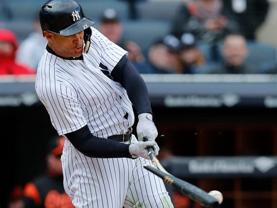 New York Yankees' Giancarlo Stanton breaks his bat as he grounded into a fielder's choice in the 10th inning of a baseball game against the Baltimore Orioles in New York, Sunday, April 8, 2018. (AP Photo/Kathy Willens)