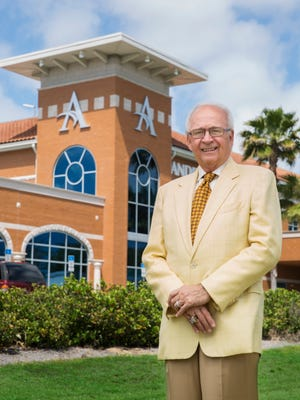 Dr. James Andrews outside the spectacular facility in Gulf Breeze that has become a national center for orthopaedic care and home to his renown sports medicine practice.