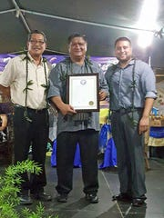 Fiestan Tasi: In celebration of the 50th anniversary of Malesso's Fiestan Tasi, Sen. Joe S. San Agustin and Sen. Fernando Esteves presented Mayor Ernest Chargualaf with a legislative resolution during the festivities on Nov. 3. Pictured from left: San Agustin, Chargualaf and Esteves.