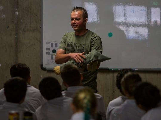 A Sheriff's Deputy talks to students in the Jr. Deputy Program during a class at the Iron County Sheriff's Office, June 21, 2016.