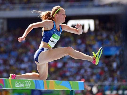 Nixa native Courtney Frerichs clears a barrier during the women's steeplechase on Saturday.
